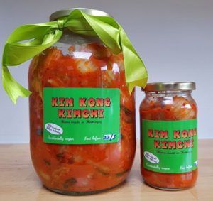 A monster-sized jar of Kim Kong Kimchi next to a regular one for scale